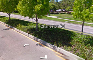White arrows overlaid on Street View