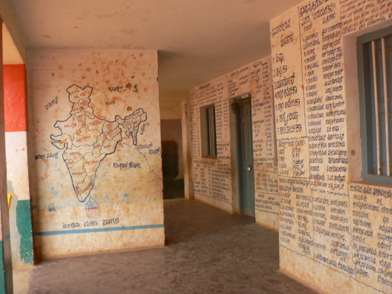 Primary School With Wall Writing And Map